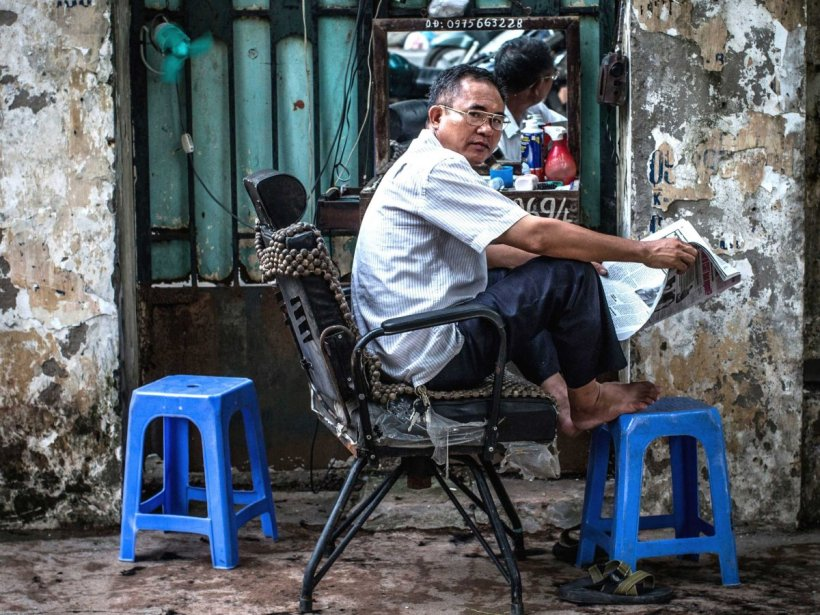 Around 13.3% of Vietnamese are self-employed. One example is Mr Kiem, a 58 year old street barber, who owns his roadside barber shop in Hanoi Vietnam (2013).